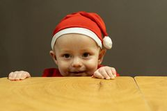 Close up portrait of cute baby boy in santa hat stock photos