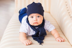 Close up portrait of cute baby boy wearing blue hat. Royalty Free Stock Photo