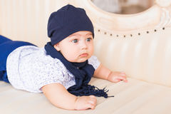 Close up portrait of cute baby boy wearing blue hat. Royalty Free Stock Images