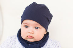 Close up portrait of cute baby boy wearing blue hat. Stock Photo