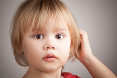 Close-up portrait of cute blond baby girl Stock Photo