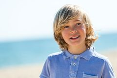 Close up portrait of cute boy outdoors. Royalty Free Stock Images