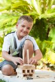 Portrait of cute boy playing with wooden blocks. Stock Photo