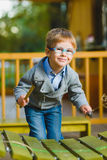 Close up portrait of cute boy playing xylophone outdoor Royalty Free Stock Images