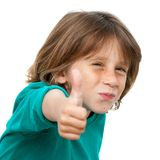 Close up portrait of cute boy with thumbs up. Royalty Free Stock Photography