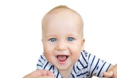 Close-up portrait of cute caucasian baby boy smiling and having fun with parents outdoors. Happy infant face with big blue eyes,sw. Eet smile and green grass royalty free stock photos
