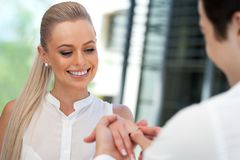 Cute girl being surprised with diamond ring. Royalty Free Stock Photography