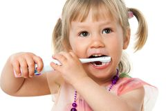 Close up portrait of cute girl brushing teeth. Stock Images