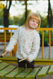 Close up portrait of cute girl playing xylophone outdoor Stock Image