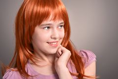 Close up portrait of cute girl with red hair posing royalty free stock photography
