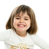 Sweet girl showing teeth. Royalty Free Stock Photos