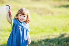 Mothers little helper having fun in the garden royalty free stock images