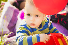 Close up portrait of cute little baby boy playing with toys Royalty Free Stock Photography