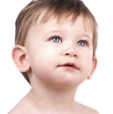 Close up portrait of cute little boy. On white background, looking up, blue eyes stock images