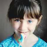 Close-up portrait of cute little girl with candy Royalty Free Stock Image