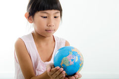 Close up Portrait of cute little girl holding earth. Sphere object. Isolated on white background Royalty Free Stock Photo