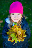 Close up portrait of cute little girl with maple leaves in autum. Close up portrait of cute little girl with yellow maple leaves in autumn park Royalty Free Stock Photos