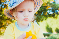 Close-up portrait of cute little girl wearing hat. Stock Images