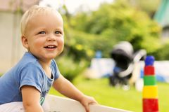 CLose-up portrait of cute smiling baby boy on the blurred nature background. Copy space Stock Photo