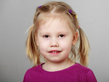 Close up portrait of a cute smiling blonde girl Royalty Free Stock Photo