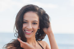 Close up portrait of cute smiling woman at beach Stock Image