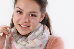 Close up portrait of cute smiling young girl on white background Royalty Free Stock Images