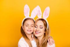 Close up portrait of cute sweet tender gentle adorable calm peac. Eful lovely with toothy beaming smile mommy and preteen girl making a wish enjoying time Royalty Free Stock Photos