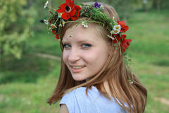 Close up portrait of Cute teen girl with a wreath Stock Photos
