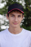 Close up portrait of a cute teenager in a baseball cap. Stock Image