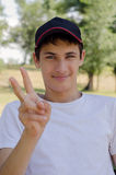 Close up portrait of a cute teenager in a baseball cap. Stock Photo