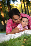 Close up portrait of the cute toddler girl and her father on the Stock Images