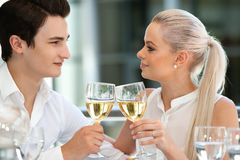 Cute couple celebrating event with wine. Royalty Free Stock Photo