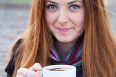 Close up portrait  of a cute young girl  drinking coffee Stock Image