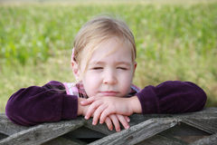 Close up portrait of a cute young girl with eyes closed thinking or imagining Royalty Free Stock Photos