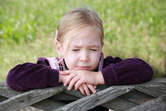 Close up portrait of a cute young girl with eyes closed thinking or imagining Stock Images