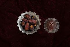 Close-up portrait of dates on a silver platter. stock photos