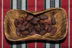 Close-up portrait of dates on a wooden platter. royalty free stock photos