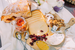 Close-up portrait of delicious food. The composition of cheese, bread, mushrooms, dried fruits, nuts and jar on the Royalty Free Stock Image