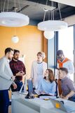 Close up portrait of diverse team members exchanging their ideas. In the loft office Royalty Free Stock Photos