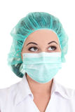 Close up portrait of doctor in blue mask and cap over white Royalty Free Stock Photography