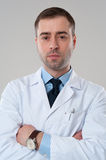 Close-up portrait of doctor with crossed arms Stock Images