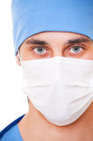 Close-up portrait of doctor in mask. Over white background Stock Images