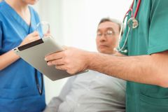 Close up portrait of doctor using tablet examining physical for royalty free stock photo