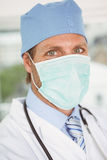 Close up portrait of doctor wearing surgical mask Royalty Free Stock Photos