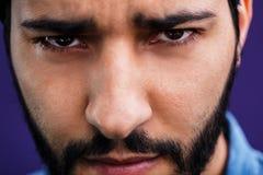 Portrait of Arabian Man. Close up portrait of eastern arabian man on purple background Stock Image