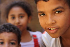 Close up portrait of egyptian children in chairty event. Close up portrait of homeless egyptian children in chairty event, Happy kids playing in the street in Royalty Free Stock Photo