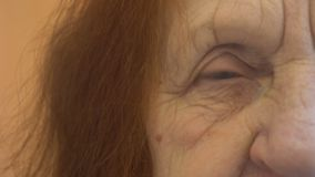 Close up portrait of a elderly woman looking at the camera stock video footage