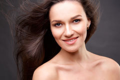 Close up portrait of elegant brunette woman with nude make up Royalty Free Stock Photography