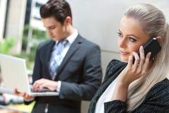 Elegant Businesswoman talking on smart phone. Stock Photo
