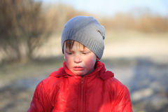Close-up portrait of an emotional boy in a bad mood Royalty Free Stock Images